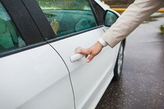Man hand opening car door Royalty Free Stock Photo