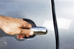 Man hand opening a car door Stock Photo
