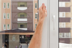Man Hand opens a plastic pvc window. Stock Photos