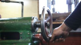 Man hand operating old controls of turning machine stock video
