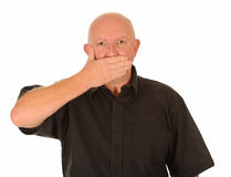 Man with hand over mouth Stock Images