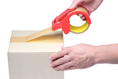 Man hand packing box with tape on cardboard box. Royalty Free Stock Images