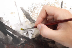 Man hand painting abstract picrure Royalty Free Stock Image