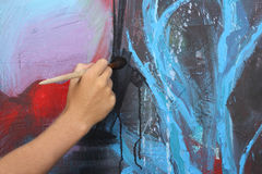 Man hand painting abstract picture Stock Images