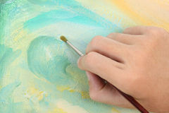 Man hand painting abstract picture Stock Photo