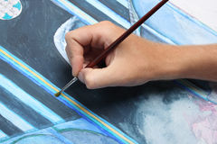 Man hand painting blue picture Stock Photos