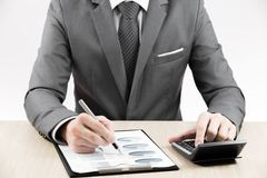 Man hand with pen and business report stock images