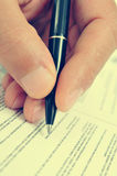 Man hand with a pen, with a retro filter effect Stock Photos