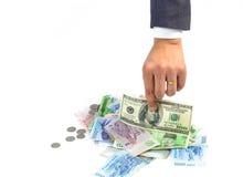 Man hand picking american dollar bank note Stock Photo