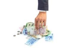 Man hand picking singapore dollar bank note Stock Image