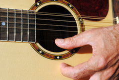 Man hand play a twelve strings guitar Stock Image
