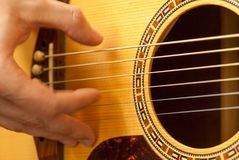 Man hand playing acoustic guitar strings recreation concept. Man hand playing acoustic guitar strings recreational activity concept royalty free stock image