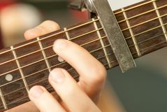 Man hand playing acoustic guitar strings recreation concept. Man hand playing acoustic guitar strings recreational activity concept stock photography