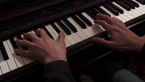 Man hand playing piano. Man playing music at a concert
