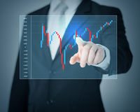 Man hand pointing at forex chart. Investment, business, future technology and money concept - closeup of man hand pointing at forex chart Royalty Free Stock Photos