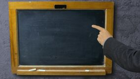 Man hand pointing with index finger on blackboard school. Hand school teacher pointing forefinger on black board stock video