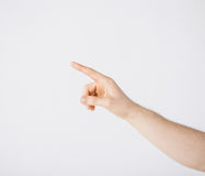 Man hand pointing at something. Picture of man hand pointing at something Stock Photo