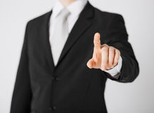 Man hand pointing at something Stock Image