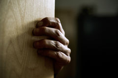 Man hand popping out from behind a door Stock Photography