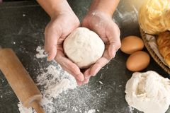 Man hand prepare bakery raw material. For Raw dough for bread  bake or cake Stock Photos