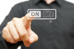 Man hand pressing ON button.  Royalty Free Stock Photography