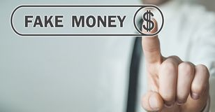 Man hand pressing dollar sign. Fake money stock photography