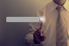 Man hand pressing on searching icon. Business browing concept Royalty Free Stock Images
