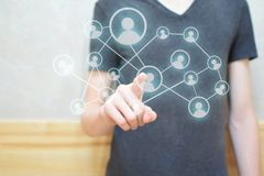 Man hand pressing social network icon royalty free stock photography