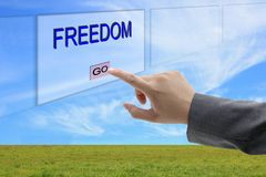 Man hand push Freedom. Asian business man hand push on Freedom button on touch screen panel Stock Photo