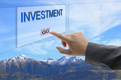 Man hand push Investment Stock Images