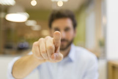 Man hand pushing a digital screen on office background Royalty Free Stock Photography