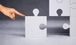 Man hand pushing puzzle piece Stock Images