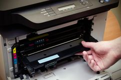 Man hand puts toner in the printer Stock Photography