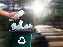 Man hand putting plastic reuse  for recycling concept environmen. Tal protection world recycle Stock Photo