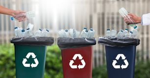Man hand putting plastic reuse  for recycling concept environmen. Tal protection world recycle Royalty Free Stock Images