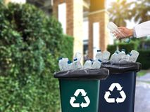 Man hand putting plastic reuse  for recycling concept environmen. Tal protection world recycle Royalty Free Stock Photo