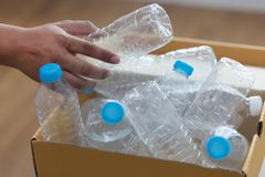 Man hand putting plastic reuse  for recycling concept environmen. Tal protection world recycle Royalty Free Stock Photos