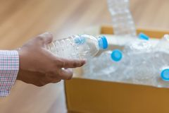 Man hand putting plastic reuse  for recycling concept environmen. Tal protection world recycle Stock Images