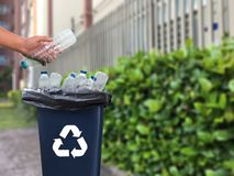 Man hand putting plastic reuse  for recycling concept environmen. Tal protection world recycle Stock Photos