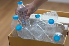 Man hand putting plastic reuse  for recycling concept environmen. Tal protection world recycle Royalty Free Stock Image