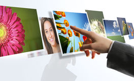 Man hand reaching images on the screen Royalty Free Stock Images