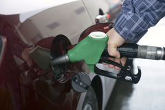 Man hand refilling up gas tank of the car Stock Images