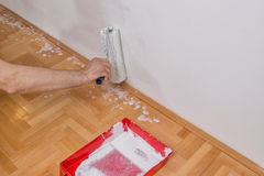 Man hand with roller painting and paint tray in front Stock Photography