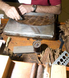 Man hand rolling cigars nicaragua Stock Images