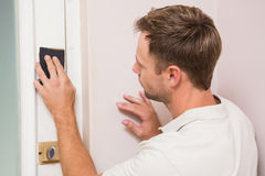 Man hand sanding the door before refinishing. At home Stock Photos