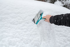 Man hand scraping ice from the car Royalty Free Stock Image
