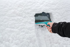 Man hand scraping ice from the car window Royalty Free Stock Images