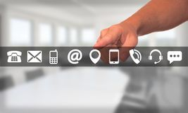 Man hand selects a set of contact icons Stock Photography