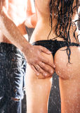 Man hand on sexy woman back Royalty Free Stock Image