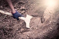 Man hand shoveling the soil on garden Stock Images
